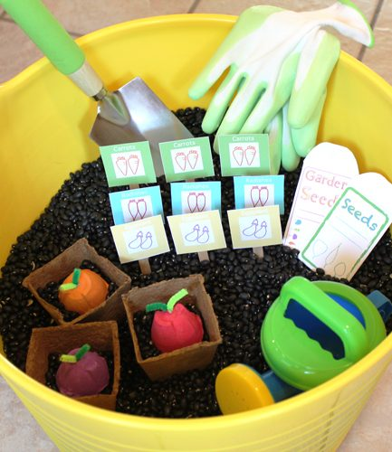 DIY vegetable garden sensory box with FREE PRINTABLES - a great way to get kids playing and learning about planting.