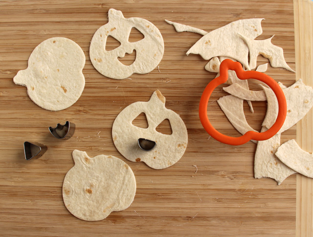 Cut pumpkin shapes from tortillas to make home made chips