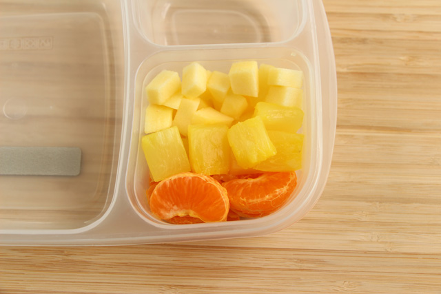 "Make a ""candy corn"" fruit salad with apple, pineapple and mandarin orange slices"