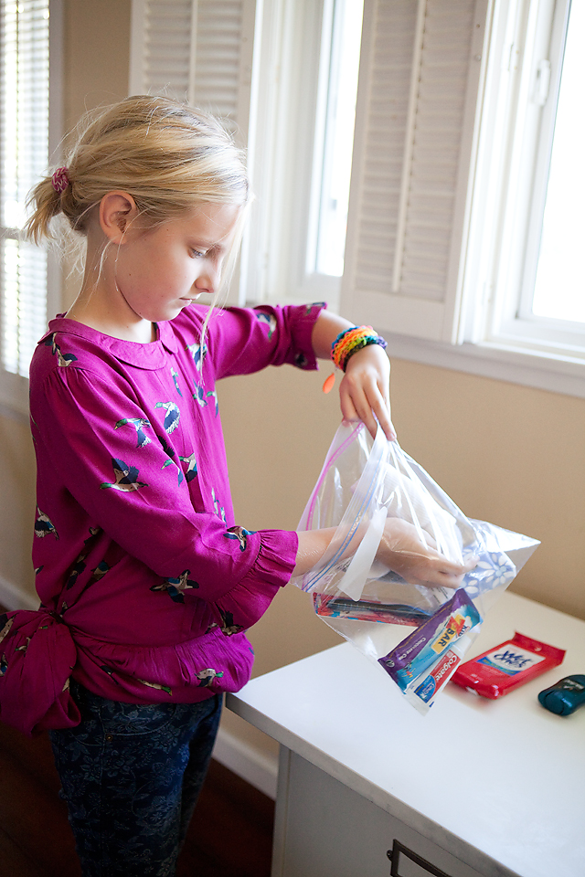 child packing a blessing bag