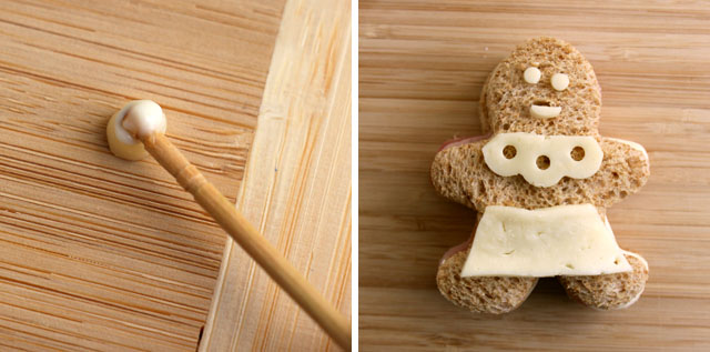"Glue cheese shapes to the bread to create a ""gingerbread"" girl."