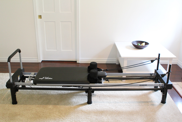 How I'm losing the baby weight with at-home pilates (love the barre attachment for doing The Barre Method workouts too).