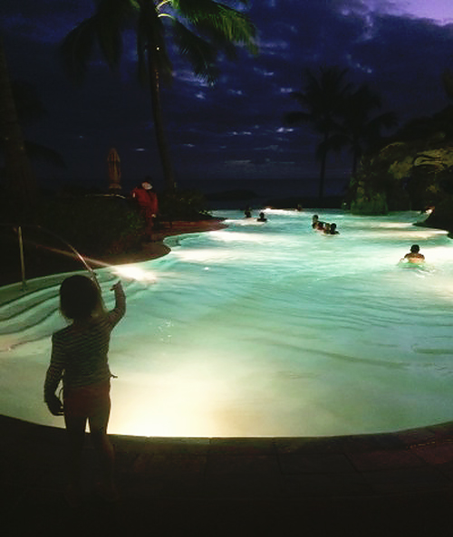 Night swimming in the starlit lagoon at Disney's Aulani Hawaiian Resort