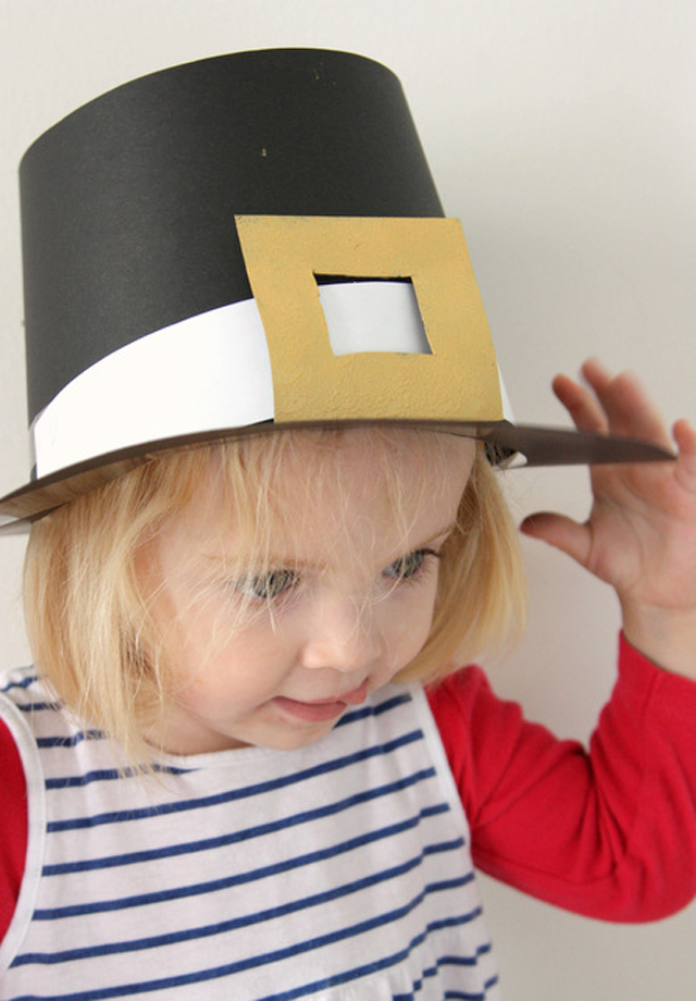 Simple DIY Pilgrim Hats - One 99 cent poster board makes two hats. The perfect project for occupying the kids while you cook.